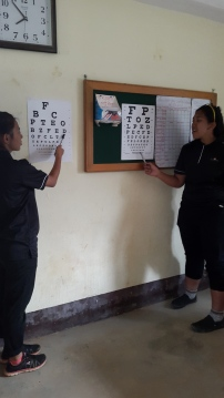 Conducting the eye sight examination and improvising to include nepali characters for the older folks