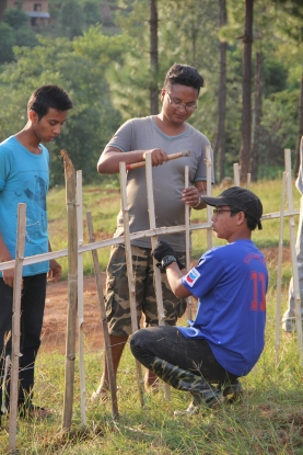 Working together to build the bamboo fences