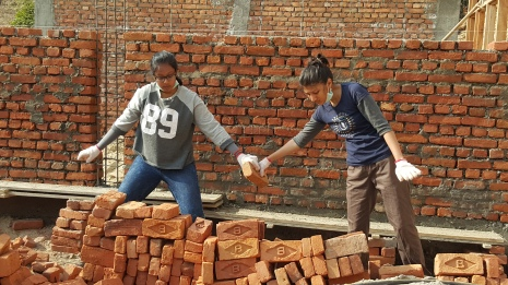 Brick by brick and working hand in hand