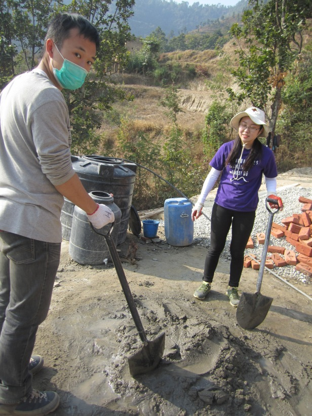 HKU students working hard mixing the 'masala' - cement mixture