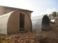 Recently completed shelter homes with brick walls and mud floors